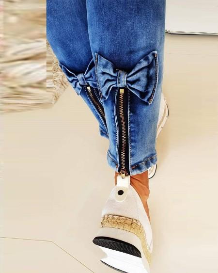 Slant Pocket Bowknot Zipper Skinny Jeans