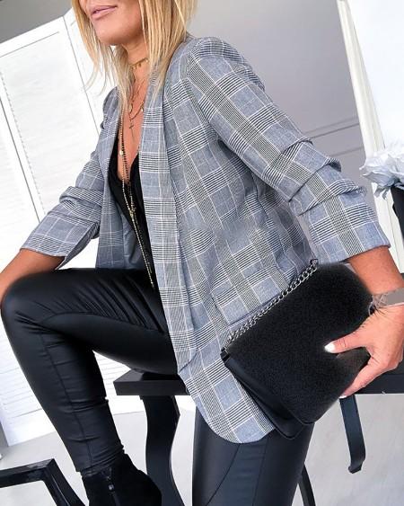 Casaco blazer com estampa xadrez colorida e design de bolso
