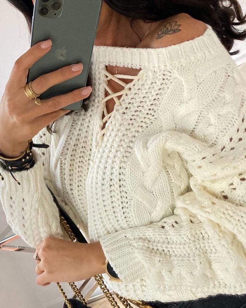 Chandail en tricot torsadé épais à lacets sur le devant